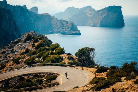 Road bikers on the road on Balearic Islands .Sea in Background. Cap de Formentor. Mallorca, Majorca, Spain Banque d'images