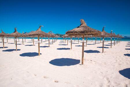 under umbrellas at arenal beach playa de palma. Mallorca spain, summer holiday photo