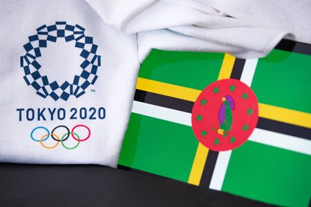 TOKYO, JAPAN, FEBRUARY. 8. 2020: Dominica at summer olympic game in Tokyo 2020, national flag, black background