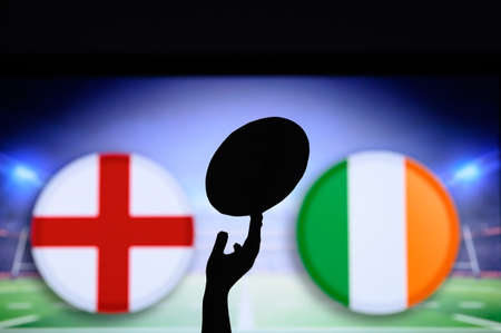 England vs Ireland, Six nations Rugby match, Rugby ball in hand silhouette 免版税图像