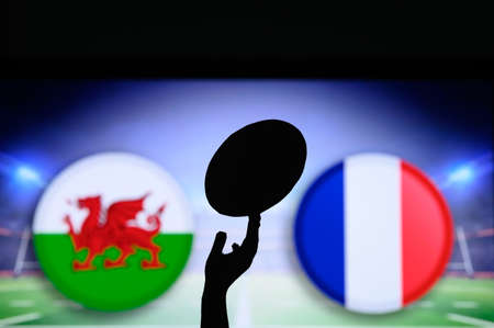 Wales vs France, Six nations Rugby match, Rugby ball in hand silhouette