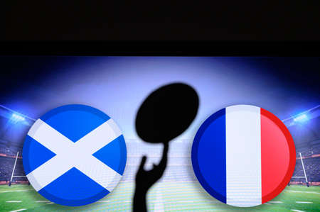 Scotland vs France, Six nations Rugby match, Rugby ball in hand silhouette 免版税图像
