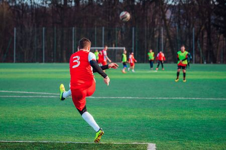 Soccer photo, player kick the ball, football professional match