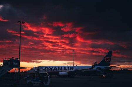 London, England - February 27, 2019: Ryanair Airplane at the airport, beautiful dramatic sky in background Editorial