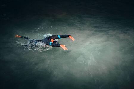 Swimmer in the sea, open water, triathlon training.