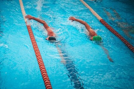 Professional swimming training. Two athlete swim together in the pool Stockfoto