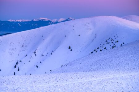Winter mountains landscape in early morning light. Purple and blue colors 免版税图像