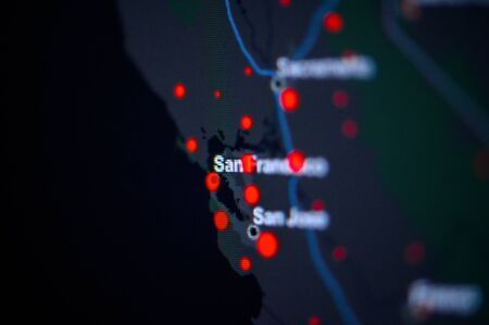 United States, West Coast, California, San Francisco . Coronavirus COVID-19 global cases Map. Red Dot showing the number of infected. Johns Hopkins University map on monitor display.