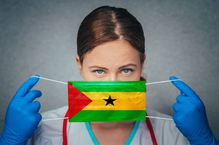 Coronavirus in Sao Tome and Principe Female Doctor Portrait hold protect Face surgical medical mask with Sao Tome and Principe National Flag. Illness, Virus Covid-19 in Sao Tome and Principe,