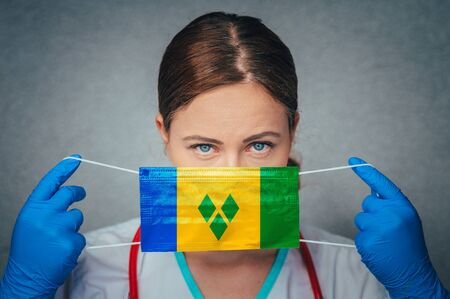 Coronavirus in Saint Vincent and the Grenadines Female Doctor Portrait hold protect Face surgical medical mask