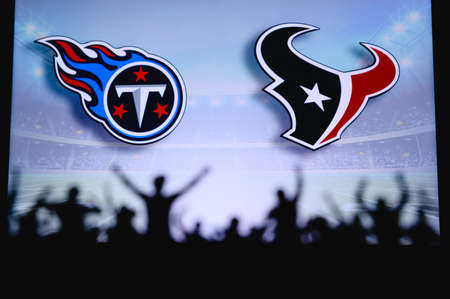 Tennessee Titans vs. Houston Texans. Fans support on NFL Game. Silhouette of supporters, big screen with two rivals in background. Editorial