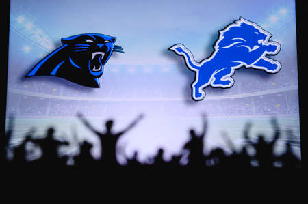 Carolina Panthers vs. Detroit Lions. Fans support on NFL Game. Silhouette of supporters, big screen with two rivals in background.