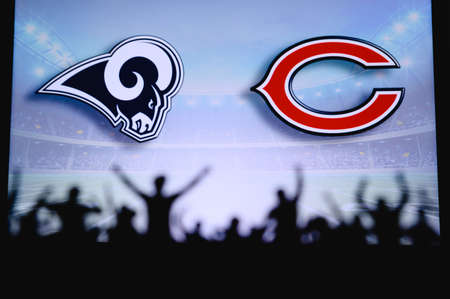 Los Angeles Rams vs. Chicago Bears. Fans support on NFL Game. Silhouette of supporters, big screen with two rivals in background. Editorial