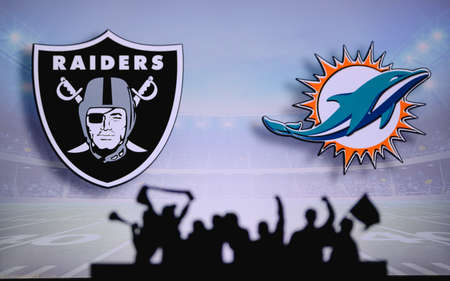 Las Vegas Raiders vs. Miami Dolphins. Fans support on NFL Game. Silhouette of supporters, big screen with two rivals in background. Editorial