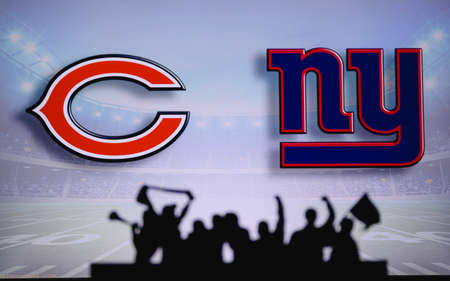Chicago Bears vs. New York Giants. Fans support on NFL Game. Silhouette of supporters, big screen with two rivals in background. Editorial