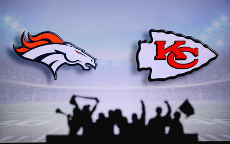 Denver Broncos vs. Kansas City Chiefs. Fans support on NFL Game. Silhouette of supporters, big screen with two rivals in background.