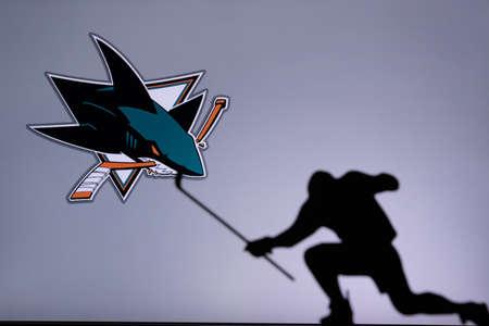 TORONTO, CANADA, JULY 17: San Jose Sharks Logo. Professional NHL hockey player celebrate goal. Silhouette photo, Edit space Editorial