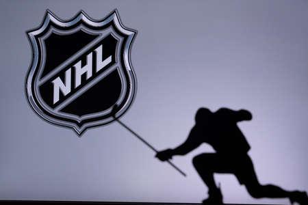 TORONTO, CANADA, JULY 17: National Hockey League Logo. Professional NHL hockey player celebrate goal. Silhouette photo, Edit space