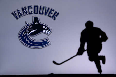 TORONTO, CANADA, JULY 17: Vancouver Canucks Concept photo. silhouette of professional NHL hockey player