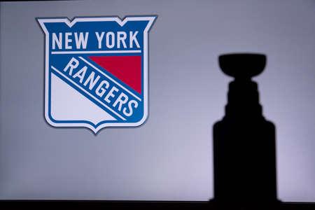 TORONTO, CANADA, JULY 17: New York RangersLogo of NHL club on the screen. Stenley Cup Trophy Silhouette.