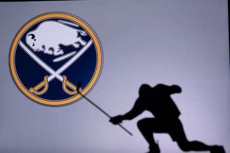 TORONTO, CANADA, JULY 17: Buffalo Sabers Logo. Professional NHL hockey player celebrate goal. Silhouette photo, Edit space