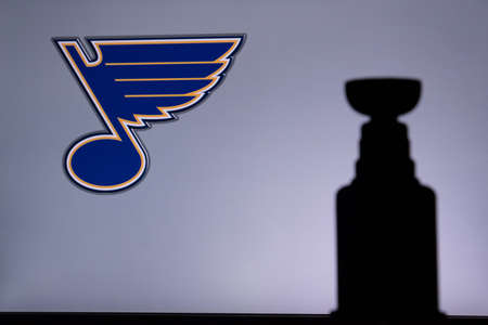 TORONTO, CANADA, JULY 17: St. Louis BluesLogo of NHL club on the screen. Stenley Cup Trophy Silhouette.