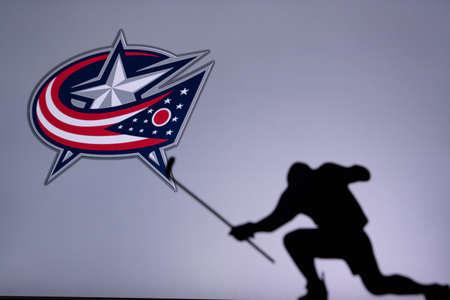 TORONTO, CANADA, JULY 17: Columbus Blue Jackets Logo. Professional NHL hockey player celebrate goal. Silhouette photo, Edit space