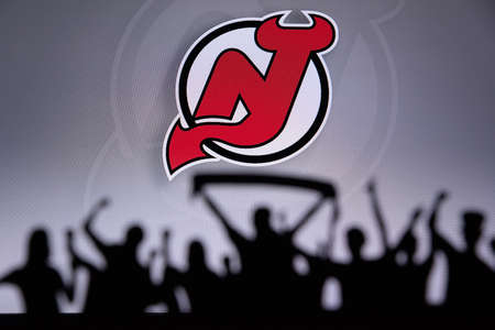 TORONTO, CANADA, JULY 17: New Jersey DevilsFans Silhouette. Crowd celebrate and support the NHL hockey Team. Sport photo, edit space