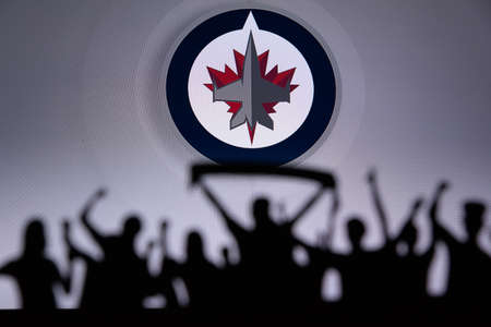 TORONTO, CANADA, JULY 17: Winnipeg JetsFans Silhouette. Crowd celebrate and support the NHL hockey Team. Sport photo, edit space