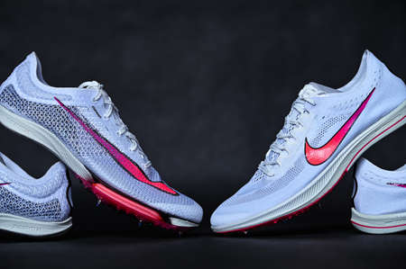 NEW YORK, USA, AUGUST 13, 2020: Nike Air Zoom Victory and Nike ZoomX Dragonfly. Racing Spikes for summer olympic game Tokyo 2021. White Color Professional running shoes, Olympic Edition.