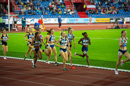 OSTRAVA, CZECH REPUBLIC, SEPTEMBER. 8. 2020: Professional middle distance track and field athletics female race. 1500 meters. Original wallpaper for summer game in Tokyo 2021