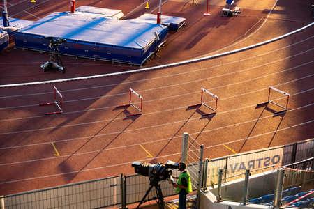 OSTRAVA, CZECH REPUBLIC, SEPTEMBER. 8. 2020: Hurdles in sunset light, professional athletics race. Original wallpaper for summer game in Tokyo 2021