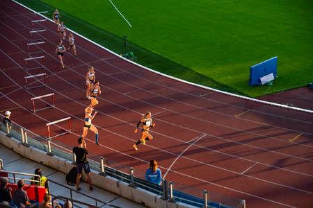 OSTRAVA, CZECH REPUBLIC, SEPTEMBER. 8. 2020: Hurdles professional track and field athletics race. Female athletes on stadium.