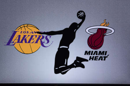 ORLANDO, USA. SEPTEMBER. 19: NBA Final 2020, Los Angeles Lakers vs Miami Heat. Covid Season final in Bubble. Silhouette of basketball player. Logos of NBA Finalists on the screen in background.