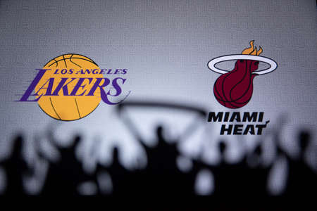 ORLANDO, USA. SEPTEMBER. 19: NBA Final 2020, Los Angeles Lakers vs Miami Heat. Covid Season final in Bubble. Silhouette of fans and supporters. Logos of NBA Finalists on the screen in background.