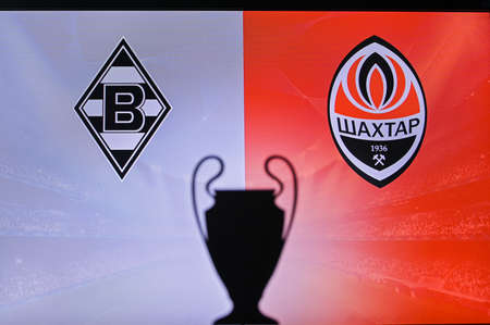 MADRID, SPAIN, NOVEMBER. 16. 2020: Borussia Mönchengladbach vs. Shakhtar Donetsk Football UEFA Champions League 2021 Group Stage match. UCL Trophy silhouette, sign of club on the screen in background