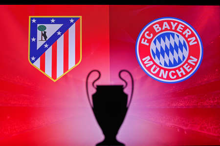 MADRID, SPAIN, NOVEMBER. 16. 2020: Atletico Madrid Vs. Bayern Munich. Football UEFA Champions League 2021 Group Stage match. UCL Trophy silhouette, sign of club on the screen in background 新聞圖片