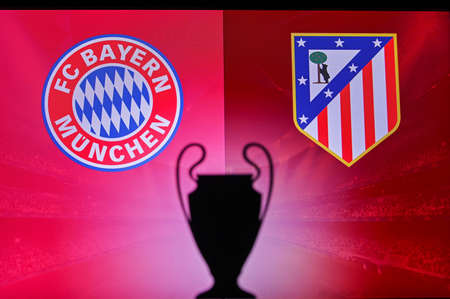 NYON, SWISS, NOVEMBER 2. 2020: Bayern Munich vs. Atlético Madrid. Football UEFA Champions League 2021 Group Stage match. UCL Trophy silhouette, sign of club on the screen in background