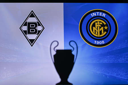 MADRID, SPAIN, NOVEMBER. 16. 2020: Borussia Mönchengladbach vs. Inter Milan Football UEFA Champions League 2021 Group Stage match. UCL Trophy silhouette, sign of club on the screen in background