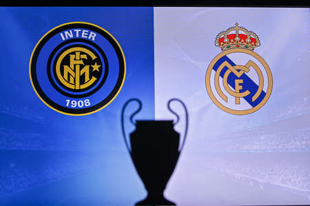 MADRID, SPAIN, NOVEMBER. 16. 2020: Inter Milan vs. Real Madrid Football UEFA Champions League 2021 Group Stage match. UCL Trophy silhouette, sign of club on the screen in background 新聞圖片