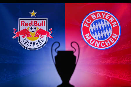 NYON, SWISS, NOVEMBER 2. 2020: Red Bull Salzburg vs. Bayern Munich. Football UEFA Champions League 2021 Group Stage match. UCL Trophy silhouette, sign of club on the screen in background 新聞圖片
