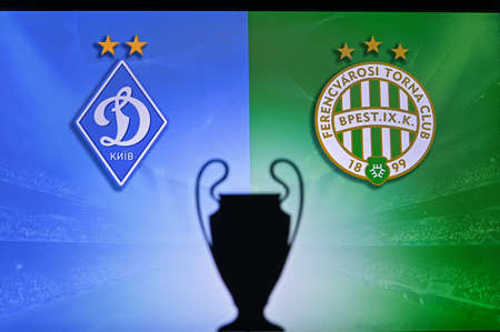 NYON, SWISS, NOVEMBER 2. 2020: Dynamo Kyiv Vs. Ferencváros Budapest. Football UEFA Champions League 2021 Group Stage match. UCL Trophy silhouette, sign of club on the screen in background