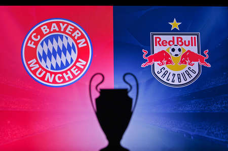 NYON, SWISS, NOVEMBER 2. 2020: Bayern Munich vs. Red Bull Salzburg. Football UEFA Champions League 2021 Group Stage match. UCL Trophy silhouette, sign of club on the screen in background 新聞圖片