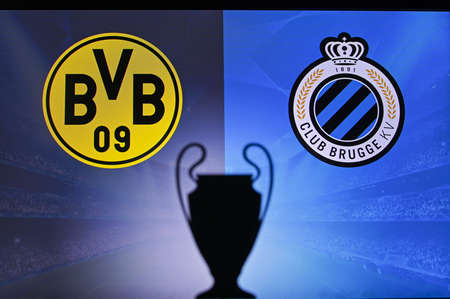 NYON, SWISS, NOVEMBER 2. 2020: Borussia Dortmund Vs. Club Brugge. Football UEFA Champions League 2021 Group Stage match. UCL Trophy silhouette, sign of club on the screen in background 新聞圖片