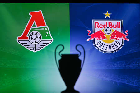 NYON, SWISS, NOVEMBER 2. 2020: Lokomotiv Moscow vs. Red Bull Salzburg. Football UEFA Champions League 2021 Group Stage match. UCL Trophy silhouette, sign of club on the screen in background