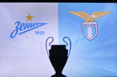 NYON, SWISS, NOVEMBER 2. 2020: Zenit Saint Petersburg vs. Lazio. Football UEFA Champions League 2021 Group Stage match. UCL Trophy silhouette, sign of club on the screen in background