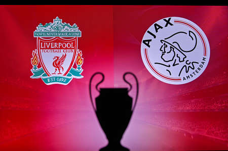 NYON, SWISS, NOVEMBER 2. 2020: Liverpool Vs. Ajax Amsterdam. Football UEFA Champions League 2021 Group Stage match. UCL Trophy silhouette, sign of club on the screen in background