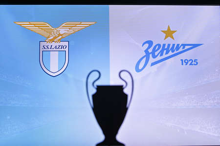 NYON, SWISS, NOVEMBER 2. 2020: Lazio Vs. Zenit Saint Petersburg. Football UEFA Champions League 2021 Group Stage match. UCL Trophy silhouette, sign of club on the screen in background