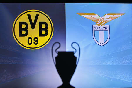 NYON, SWISS, NOVEMBER 2. 2020: Borussia Dortmund Vs. Lazio. Football UEFA Champions League 2021 Group Stage match. UCL Trophy silhouette, sign of club on the screen in background