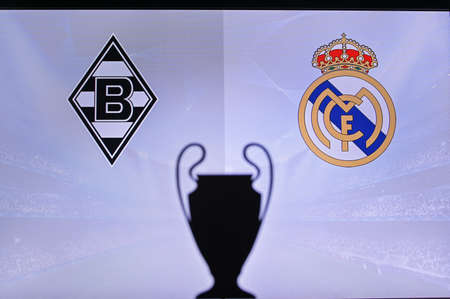 MADRID, SPAIN, NOVEMBER. 16. 2020: Borussia Mönchengladbach vs. Real Madrid. Football UEFA Champions League 2021 Group Stage match. UCL Trophy silhouette, sign of club on the screen in background 新聞圖片